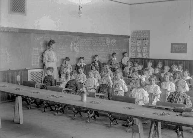 CVA - SGN 1586 - [Teacher Dorothy Alison and students in classroom of Model School] 1907? C. Bradbury photo.