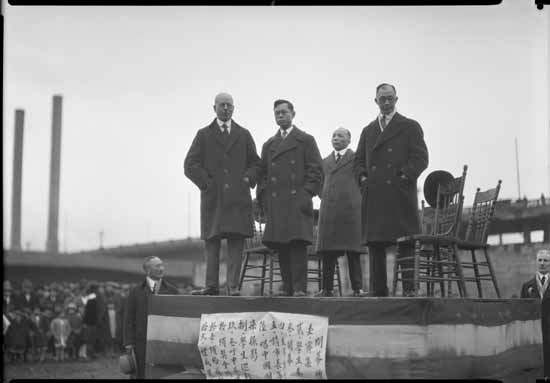 VPL 22689 - Mayor LDT standing on platform of Chinese playground on Carrall & Pender March 24, 1928 Dominion Photo.