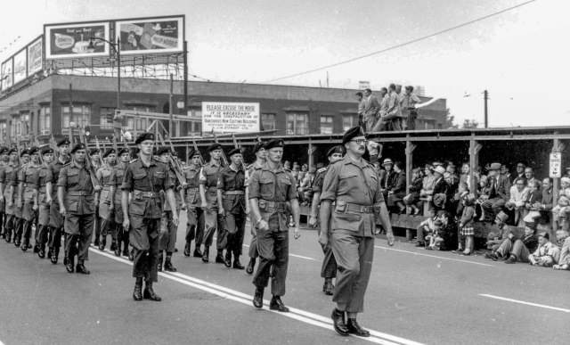 Crop of CVA 180-7871 - Soldiers in P.N.E. parade heading north on Burrard Street, near Pender Street 1953.