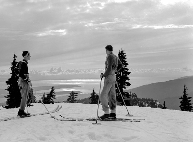 CVA 586-123 - Two skiers looking at a view of Point Grey and Stanley Park from the top of Mt. Seymour, B.C. 1940 Don Coltman photo.
