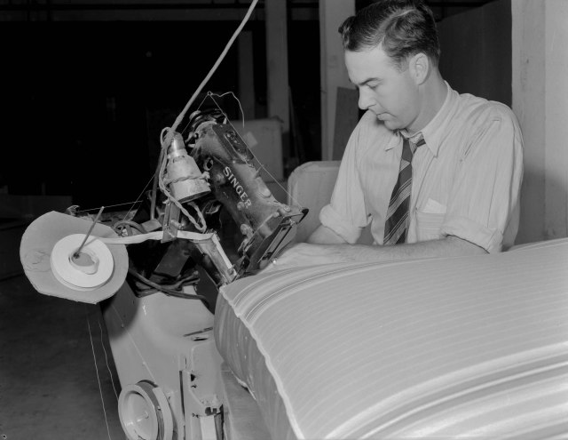 CVA 1184-1987 - [Man sewing cushions at Hammond Furniture] 1940-48 Jack Lindsay photo