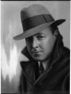 Photographer George Marsden wearing a hat and trench coat. Negative is part of the Rinehart-Marsden personal collection n.d.