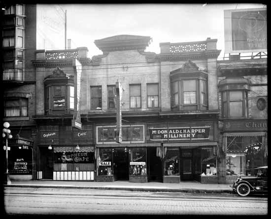 vpl 21401 Stores on Granville Street. 1923. Dominion Photo.