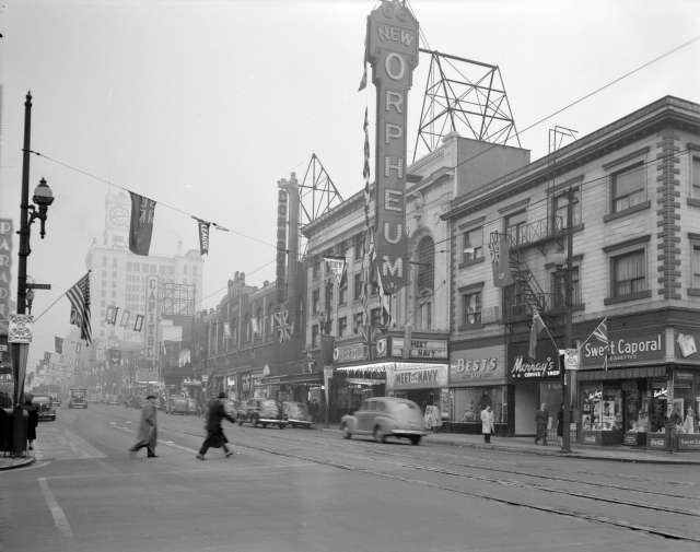 CVA 1184-2290 - [View of Granville Street looking north from Smithe showing the Orpheum Theatre, Commodore, and Capitol Theatre] 1946 Jack Lindsay photo.