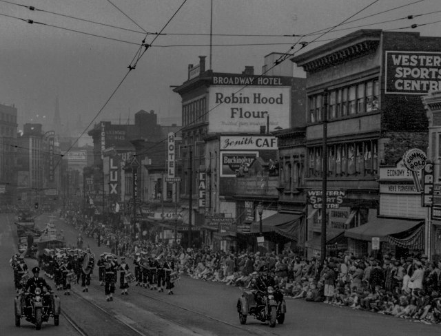 CVA 180-1555 - View of floats and bands along 100 block East Hastings Street during 1949 P.N.E. Opening Day Parade 1949 Patton's studio