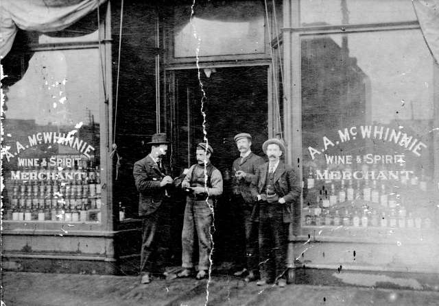 CVA 371-2418 - [Exterior of A.A. McWhinnie Wine and Spirit Merchant at 55 East Hastings Street] ca 1901
