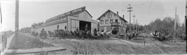 PAN NIVA - [View of teamsters and horse-drawn delivery wagons in front of Coast Lumber and Fuel Co. Ltd.] 191- WJ Moore photo.