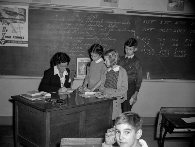 CVA 1184-1411 - [Children at teacher's desk] 1942 Jack Lindsay photo