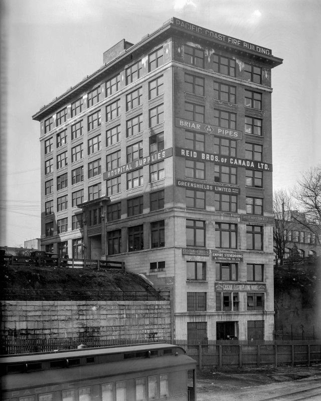 CVA 99 - 3307 - Pacific Coast Fire Insurance Building [325 Howe Street] 1920 Stuart Thomson photo (INTERESTING VIEW FROM THE CPR TRACKS)