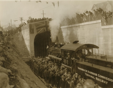 National Harbour Commission Locomotive Pulling Train through subway. University of British Columbia. Library. Rare Books and Special Collections. Uno Langmann Family Collection of B.C. Photographs