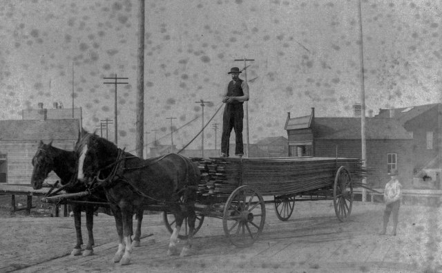 Str P221 - [A horse-drawn lumber wagon at the corner of Hastings Street and Cambie Street] 1888