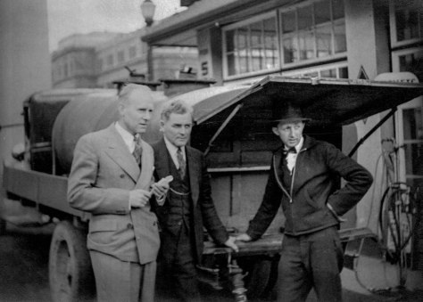 CVA 1495-33 - What We Have We'll Hold! [David Spencer's Ltd. employees and unidentified man during gasoline strike of April 1940]_