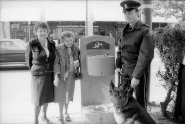 cva-775-189-28-unidentified-woman-theresa-galloway-constable-rob-bosley-and-police-dog-sport-at-drinking-fountain-inauguration-1986