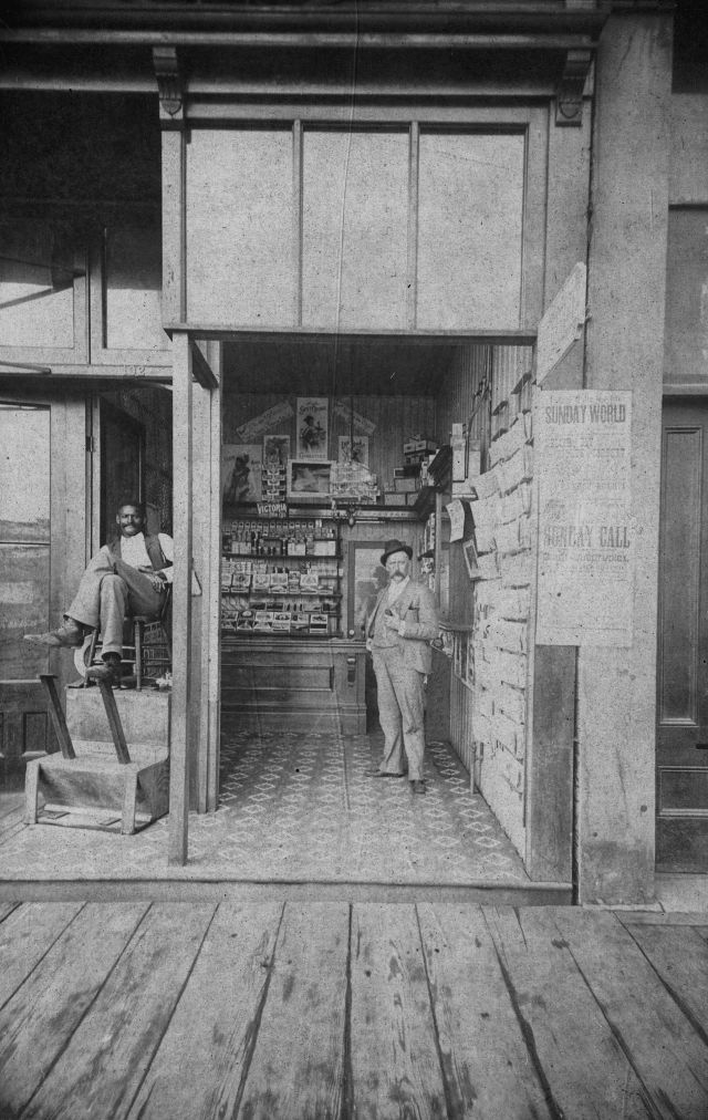 Bu P264 - [Exterior of Fred Ackers - Tobacconist and shoeshine - 132 Cordova Street] cxa 1895