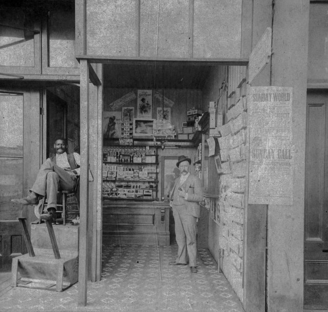bu-p264-exterior-of-fred-ackers-tobacconist-and-shoeshine-132-cordova-street-ca-1895