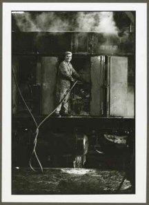 "VPL 88660 ""Man working in machine shop on railcar no. 7073"". Nina Raginsky, 1972."