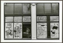 "VPL 88679 ""View of a man through a heavily graffitied window"". Nina Raginsky. 1972."