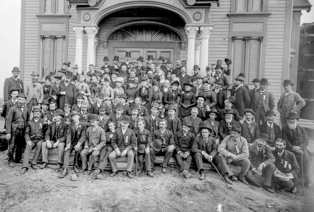 LGN 484 - [Men and women assembled outside First Baptist Church, at the southwest corner of Dunsmuir and Hamilton Streets] 1889