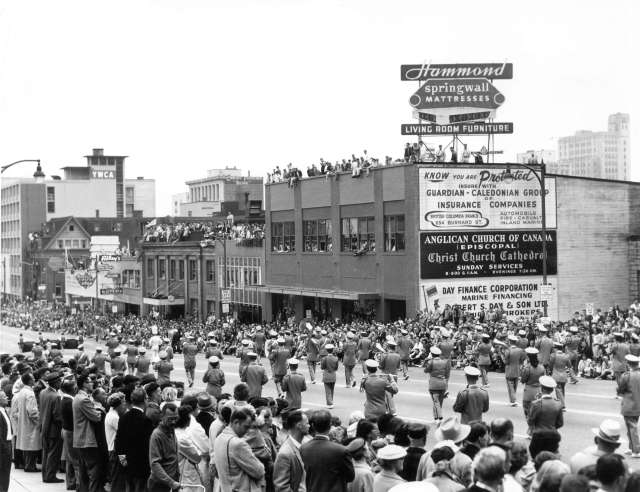 CVA 180-3821 - Marching band in 1959 P.N.E. Opening Day Parade Graphic Industries photo. (Hammond ad atop former Oxford Motors then later the ARP bldg - NOw PArk Place park Adjacent to C