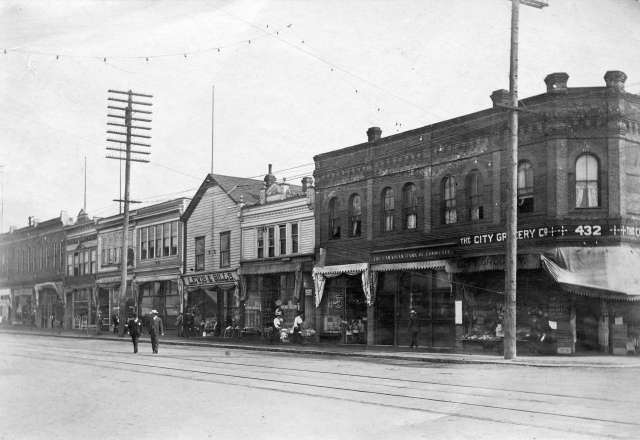 CVA 166-2 - Street Scene in Vancouver showing block of shops at 432 Westminster Avenue (Main Street) PTTimms ca 1908