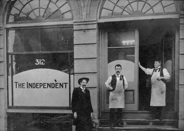 CVA 677-828 - Jos. Niles, H. Geo. Bartley, and H. Cowan [standing outside office of] the Independent, 312 Homer Street 1900