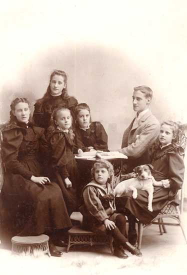 Children of G.E. Corbould. - [ca. 1895]. S J Thompson. Grace C is sitting at far right with dog on her lap. Record ID 18282 New Westminster Archives
