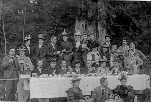 SGN 965 - [Men and women eating strawberries at a picnic in Stanley Park] 189-?