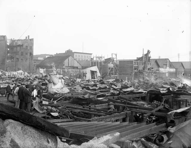 CVA 14-1 - Crowd at the site of Champion and White warehouse (935-941 Main Street) after destroyed by fire July 1912
