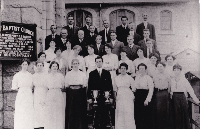 cf5b9bfb7b With the BC Music Festival cups in front of T. Bonne Millar, Choirmaster  and Organist of the Church (1911-1921). Courtesy, First Baptist Church  Archives.